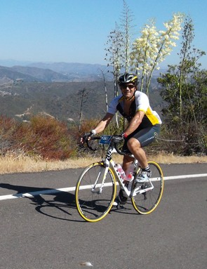 Sure Jeff is smiling now, but at this point he still has three miles of climbing