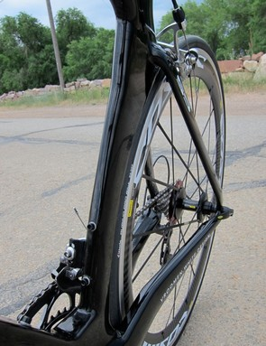 The rear wheel is almost completely hidden by the seat tube