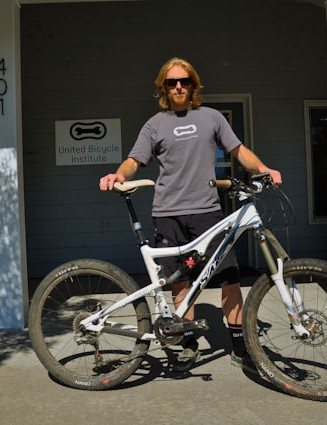 A true blue-collar pro, Riddle poses with his bike during a quick lunch break from teaching at UBI