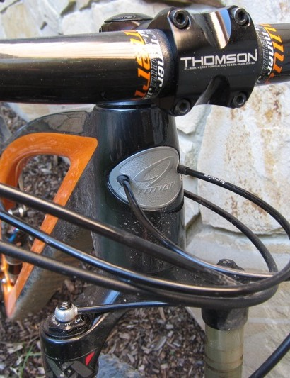 The shifter cables run bare from the head badge through the down tube to the bottom bracket
