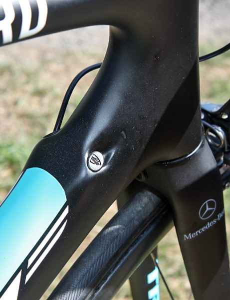Trek's internal cable routing setup can accommodate either mechanical or electronic drivetrains. A little plug seals the lone unused hole while the rest of the ports are used for the wiring harness