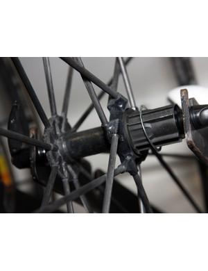Rarely seen (and thus far never reaching production), the Mavic R-Sys Ultimate wheels use tubular carbon fiber spokes bonded into the minimal aluminum and carbon fiber hub shell