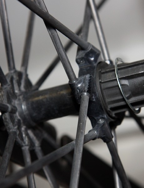 Rarely seen (and thus far never reaching production), the Mavic R-Sys Ultimate wheels use tubular carbon fiber spokes bonded into the minimal aluminum and carbon fiber hub shell
