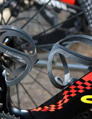 Two Tacx Tao Carbon bottle cages hold bidons at the ready