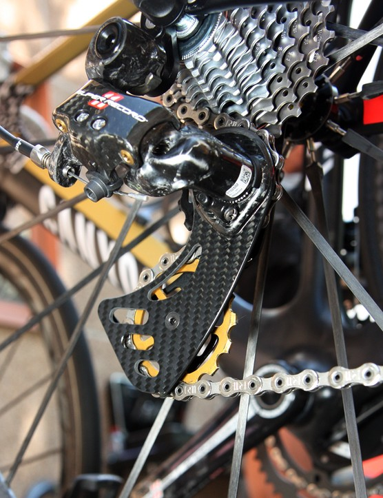 Philippe Gilbert (Omega Pharma-Lotto) is running a Berner carbon fiber cage on his Campagnolo Super Record rear derailleur with dual oversized pulleys that are said to reduce drivetrain friction