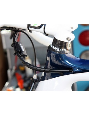 A little bit of wire wrap keeps things tidy on this Movistar Pinarello Dogma2
