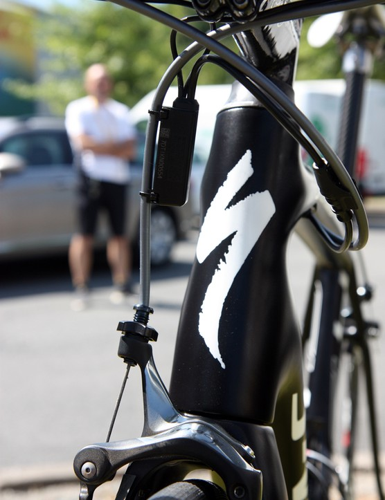 The extra-wide top tube and down tube give the head tube a distinctly curvy profile. Oh, and that ominous figure standing in the background? He's part of the team's security detail
