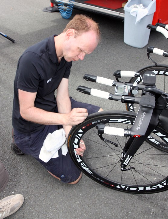 BMC mechanics carefully inspected each tire before the team time trial, extracting any bits of glass or other material with a pick in order to prevent punctures down the road