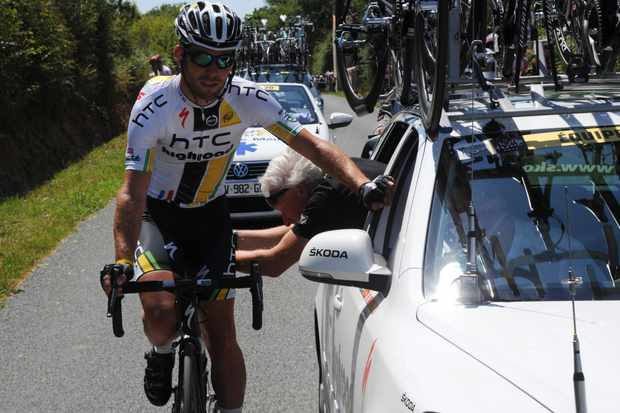 Mark Cavendish has his bike checked during stage 3