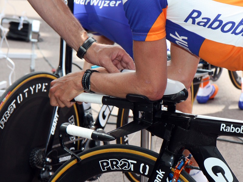 Rabobank's custom time trial bottles and cages are designed so that the rider doesn't have to break his tuck to take a drink - just slide an arm back a little, grab and go