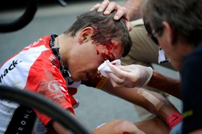 Janez Brajkovic is treated after a crash in stage 5