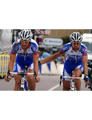 Tom Boonen (L) shepherded to the line by teammate Addy Engels. Boonen crashed earlier in the stage