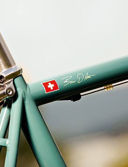 A flag on the frame displays Bruno's Swiss heritage