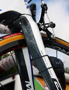 The front end of Quick Step's Eddy Merckx EMX-7 frames use a distinctive weave beneath the clear coat