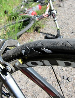 The rider experienced a double carbon clincher wheel failure; both front and rear blew out