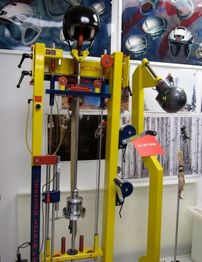 The left tests straps, while the near fixture tests the ability to resist roll-off
