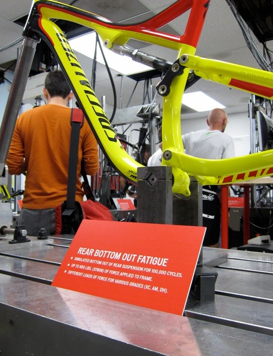 In the test lab on the 'bottom out fatigue test machine' with a new 2012 M5 alloy Stumpjumper FSR Evo; the test runs 100,000 cycles with various weights depending on the intended use