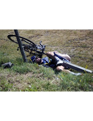 Jonny Hoogerland hits a barbed wire fence after being taken out by a car during stage 9 of the Tour de France