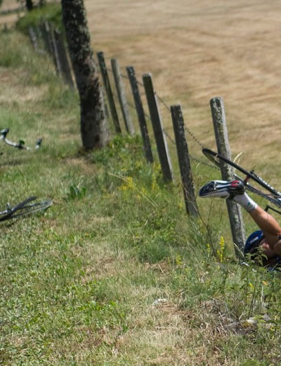 Flecha picks himself up while Jonny Hoogerland faces a more painful task in the barbed wire
