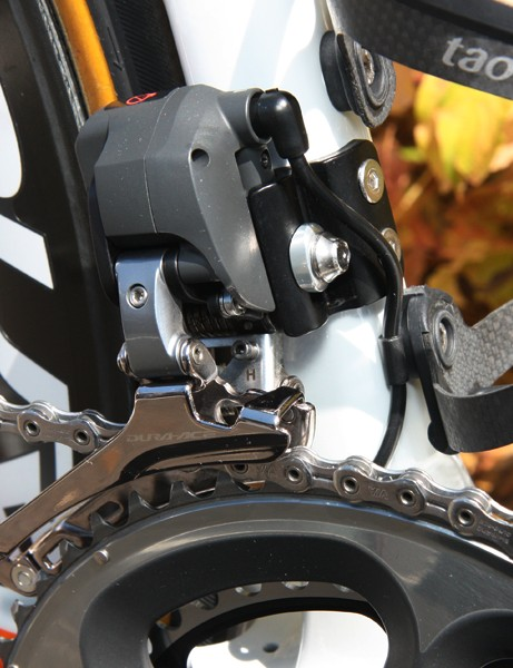 The Shimano Dura-Ace Di2 front derailleur is mounted to a bolt-on tab. Note the small clamp securing the wire beneath the lower bottle cage hole
