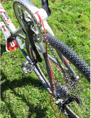 The full-length housing exits the down tube in front of the bottom bracket and continues to the derailleurs