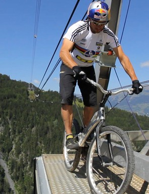 Kenny Belaey performs stunts on top of the Vanoise Express cable car