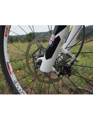 Though billed as a lightweight race or trail bike, Scott still spec a more versatile 180mm front rotor