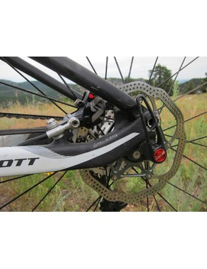 Scott have switched to post mount tabs and tucked the rear brake caliper inside the rear triangle on new carbon fiber Sparks for better protection from impact and lighter weight, not to mention a stouter foundation for squeal-free braking