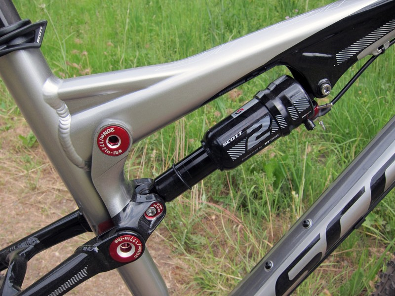 The new DT Swiss Nude 2 rear shock and forged one-piece aluminum link yield a much cleaner look than in years past