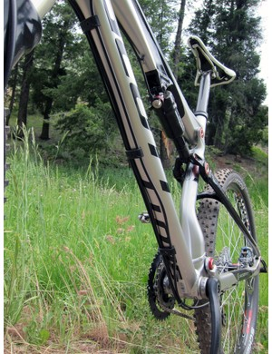 The full-length derailleur housings and rear brake line are all run on the underside of the down tube on the 2012 alloy Scott Spark