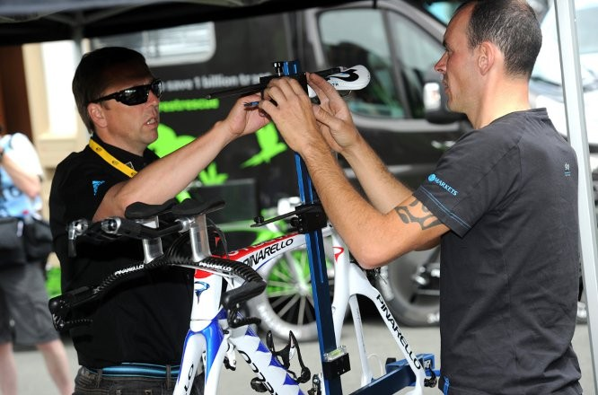Team Sky Head of Operations Carsten Jeppeson and mechanic Diego Costa discuss the set up of a time trial bike