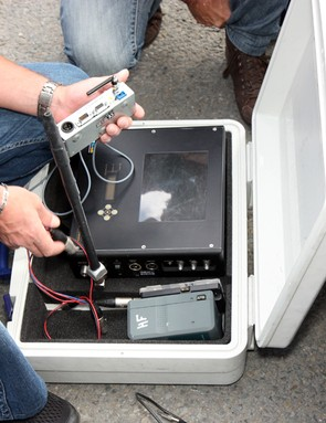 Vacansoleil-DCM preps its radio system before a stage in this year's Tour de France.