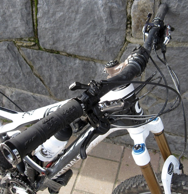 The mission control center includes Shimano XT shifters, a Gravity Dropper lever, and the Fox DYAD 150mm/90mm travel adjuster
