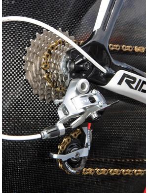 A SRAM Red rear derailleur moves a KMC chain across the SRAM OG-1090 cassette on Vacansoleil-DCM's Ridley Dean time trial bikes