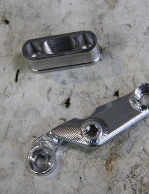Example prototype parts include this internal cable routing port and front derailleur chain slap protector