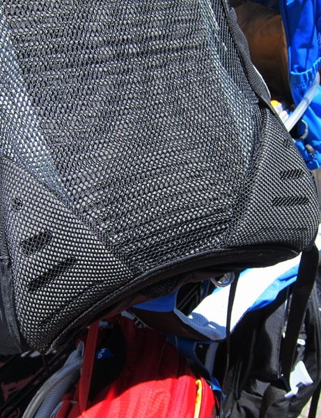 Extra pads around the bottom corners of the Osprey Syncro protect the rider's hips from the hard points of the built-in frame