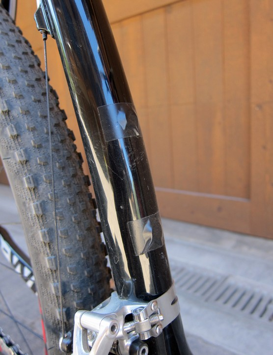 Electrical tape seals up the unused seat tube water bottle mounts from water