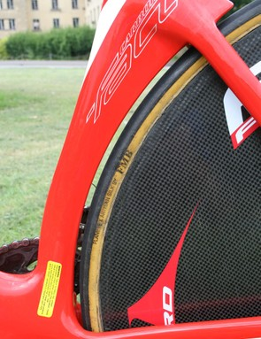 The space between the seat tube and the rear wheel is to reduce turbulence caused by the spinning wheel