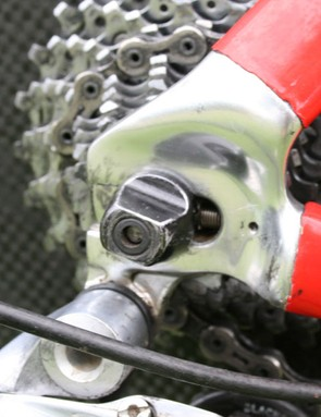The horizontal rear dropouts include adjusting screws for wheel positioning