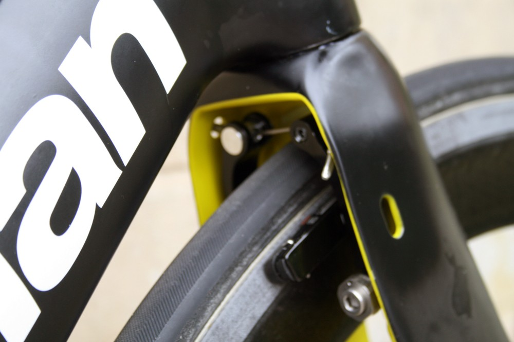 The TRP front brake is integrated into the fork to hide it from the wind. But it's also accessible for easy adjustment