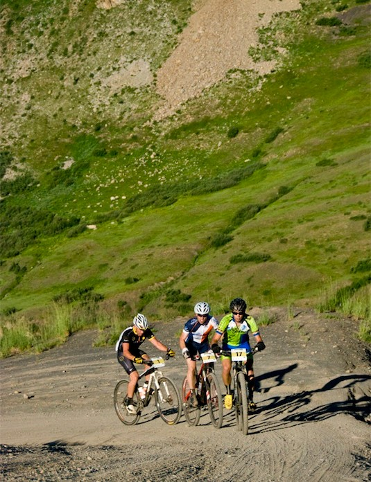 Travis Scheefer, Cameron Brenneman & Lance Armstrong round the corner. Approximately ten miles into the course the three initial leaders attacked the  almost 1,000 ft climb of the Slate Switchbacks or Slate d'Huez as it is lovingly called by local Crested Butte riders