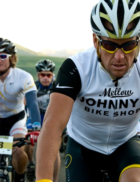 Lance Armstrong contemplates the mileage and elevation gain that lie before him as he and the rest of the competitors roll through Historic Downtown Crested Butte