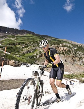 Lance Armstrong hikes through the 100yd snow plug below Emerald Lake. Racers had to cross this snowfield at 11,000ft twice during Sunday's race