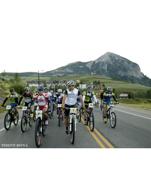 The would be Men's and Women's overall winners, Rebecca Rusch and Lance Armstrong discuss gearing, goos, and controlled starts as the peloton is escorted out of Mt. Crested Butte and through downtown to start the race
