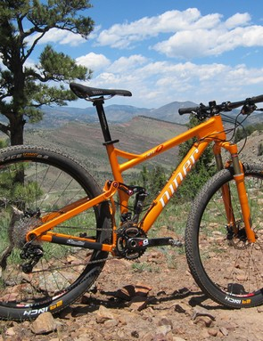 The Niner JET 9 features an impressive suspension design wrapped in a beautiful metallic orange wrapper