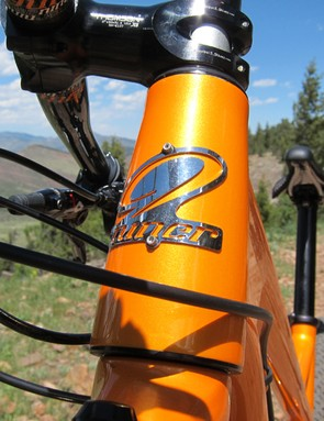 It's nice to see a proper bolt-on metal head tube badge on a production bike
