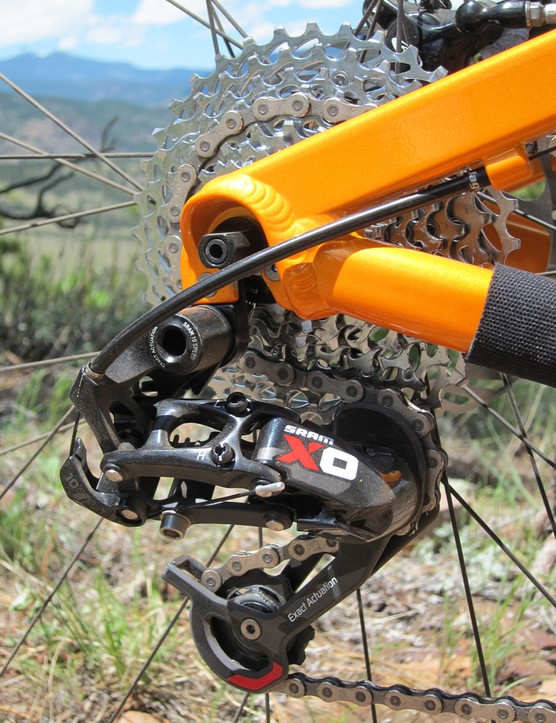 The 2x10 transmission allows for a shorter rear derailleur cage and fewer chain links.  Chain slap was noticeably reduced relative to the 3x10 drivetrains as a result