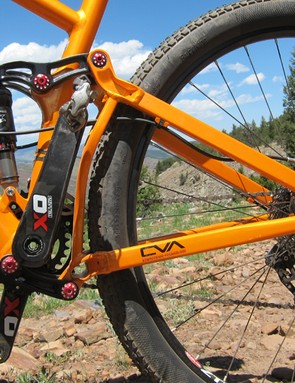 The fully enclosed rear triangle is joined to the main frame by four separate forged aluminum links