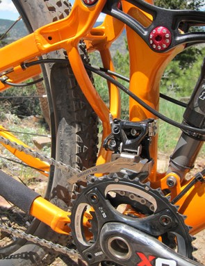 The welded-in rear yoke isn't as close to the tire as this picture might suggest.  Even so, tire clearance could be an issue in sticky mud