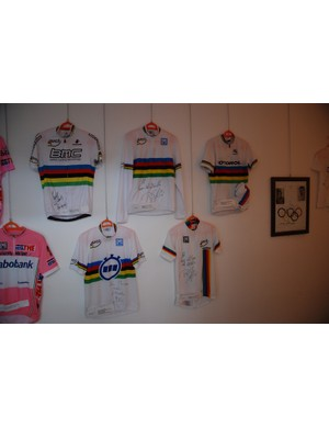 Just a few signed World Champions jerseys along with the prized pink jersey from the Giro